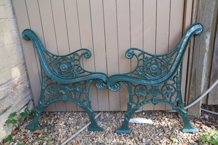 The wrought iron sides, cleaned and repainted.