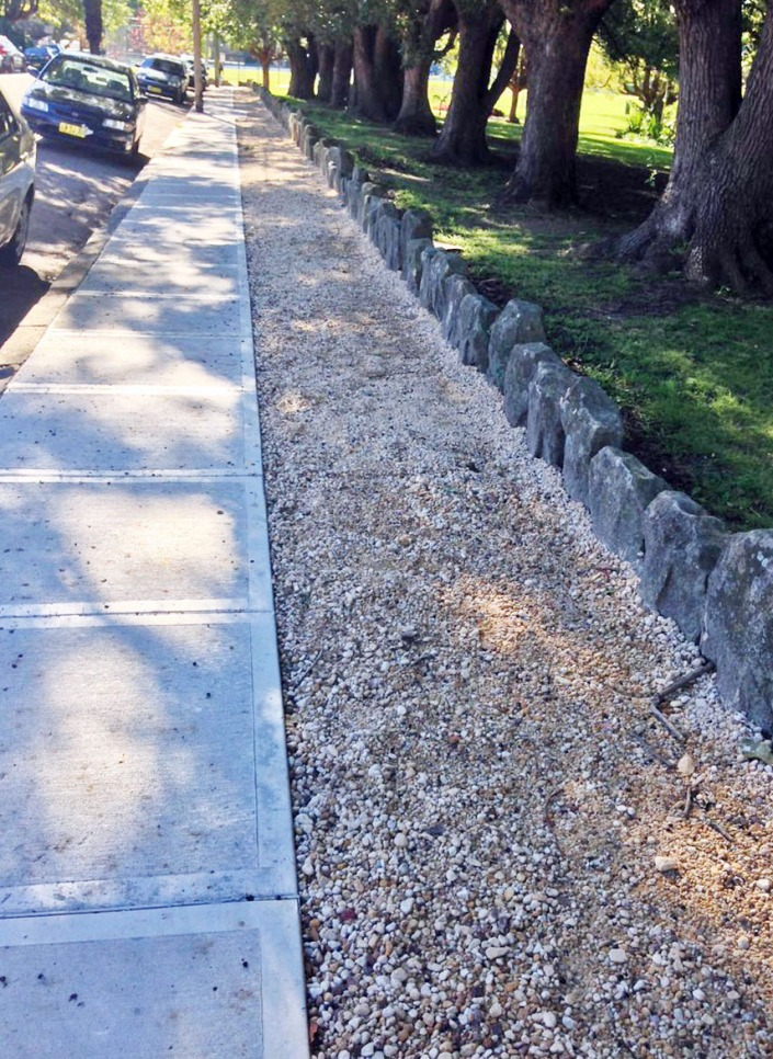 The pavement running alongside Petersham Park: half concrete, half gravel.