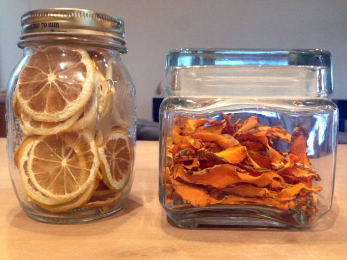 Two jars, of dried lemon and tumeric slices.