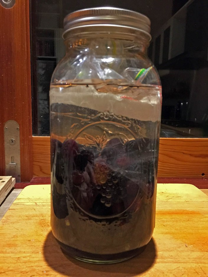 Olives 'de-bitering' in a jar of water for 20 days