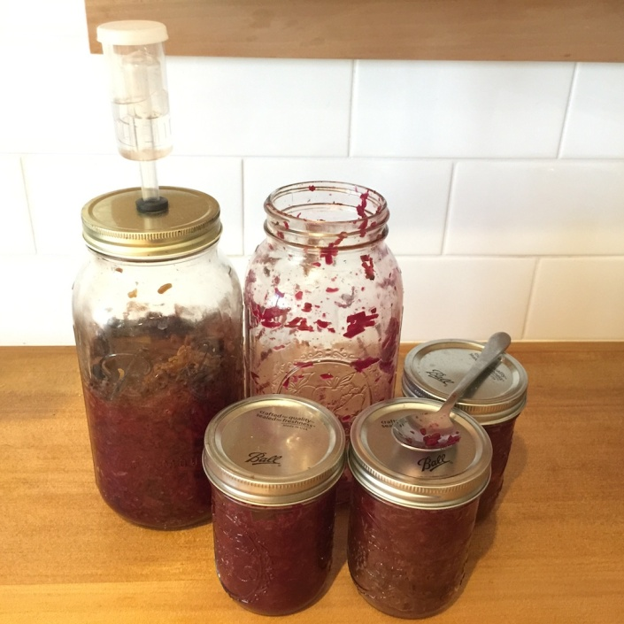 Packing jars full of delicious beet-kraut